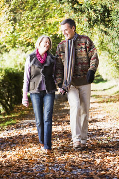 retired couple walking along a community path