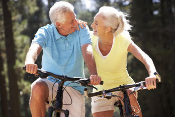 senior couple riding bicycles in the country